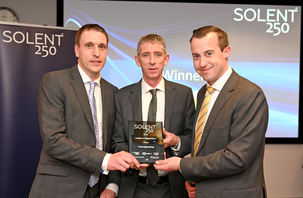 AWARD: From left, Trant Engineering's James Henderson and Brendan Dowd receive The Solent 250 Award for Leaders in Digitisation. Right is James Tetley from RSM, one of the sponsors.