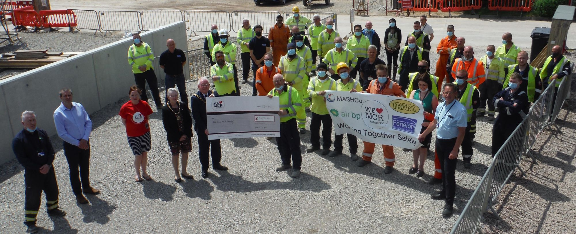 DONATION: A charity cheque for £3,680 is presented to the city's Lord Mayor, Councillor Tommy Judge, at Manchester Airport. Holding the cheque with the Lord Mayor is Mick Satell, Trant Engineering Site Foreman.