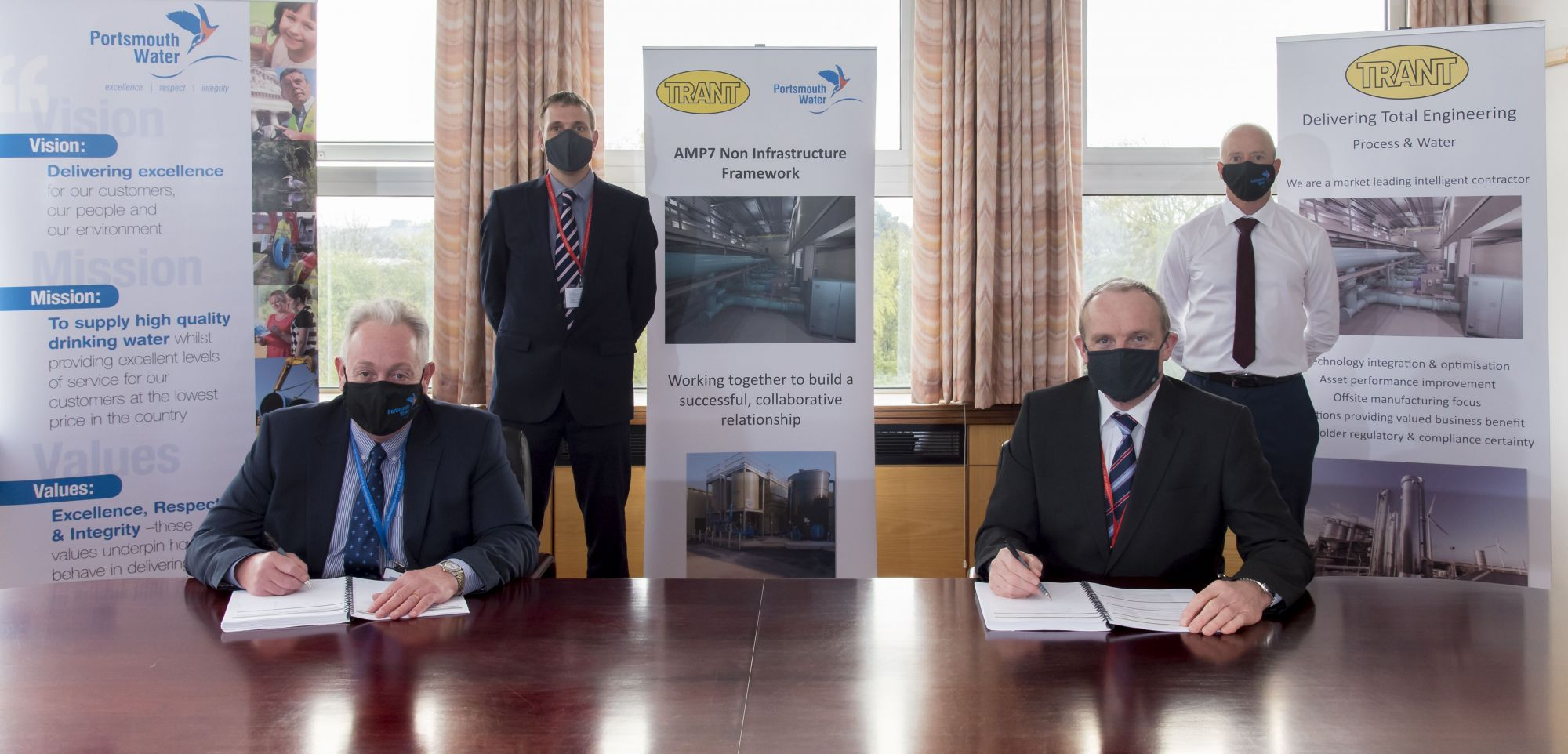 Portsmouth Water has signed an initial four-year framework agreement with Trant Engineering for the remainder of the water company's seventh asset management period (AMP7) to 2025, with the option of a five-year extension for the AMP8 regulatory period to 2030. The contract is worth up to £20 million. Scope of work in the non-infrastructure investment programme includes maintenance and new projects for assets above and below ground. Pictured at the signing, from left, are, seated, Bob Taylor, Chief Executive, Portsmouth Water, and, Gerry Somers, Managing Director, UK, Trant Engineering. From left at the back, James Henderson, Director – Process & Water, Trant Engineering, and Mark Mills, Head of Production & Asset Delivery, Portsmouth Water. Protective face coverings were worn inside Portsmouth Water's head office in Havant, near Portsmouth, where the signing took place. Portsmouth Water supplies clean drinking water from boreholes, springs and a river to 320,000 properties in Hampshire and West Sussex.