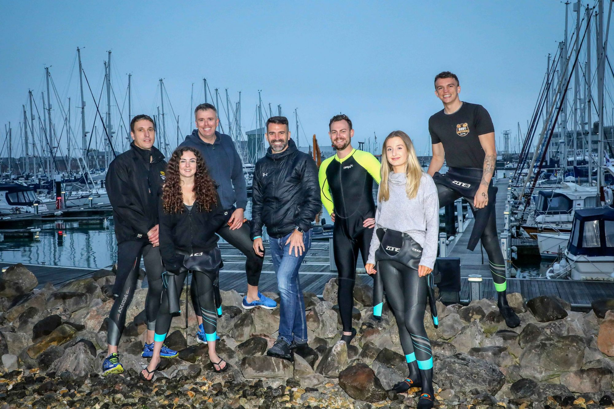 AT THE READY: Employees of Trant Engineering took part in a charity swim across the Solent from Gosport to Ryde, Isle of Wight, with a pep talk by Saints legend Francis Benali, centre. From left, James Henderson (Director – Process and Water), Jess Howe (Buyer), David Graham (Framework Manager), Terry Elstone (Consultant Commercial Manager), Louisa Davies (Quantity Surveyor) and James Stead (Project Engineer).