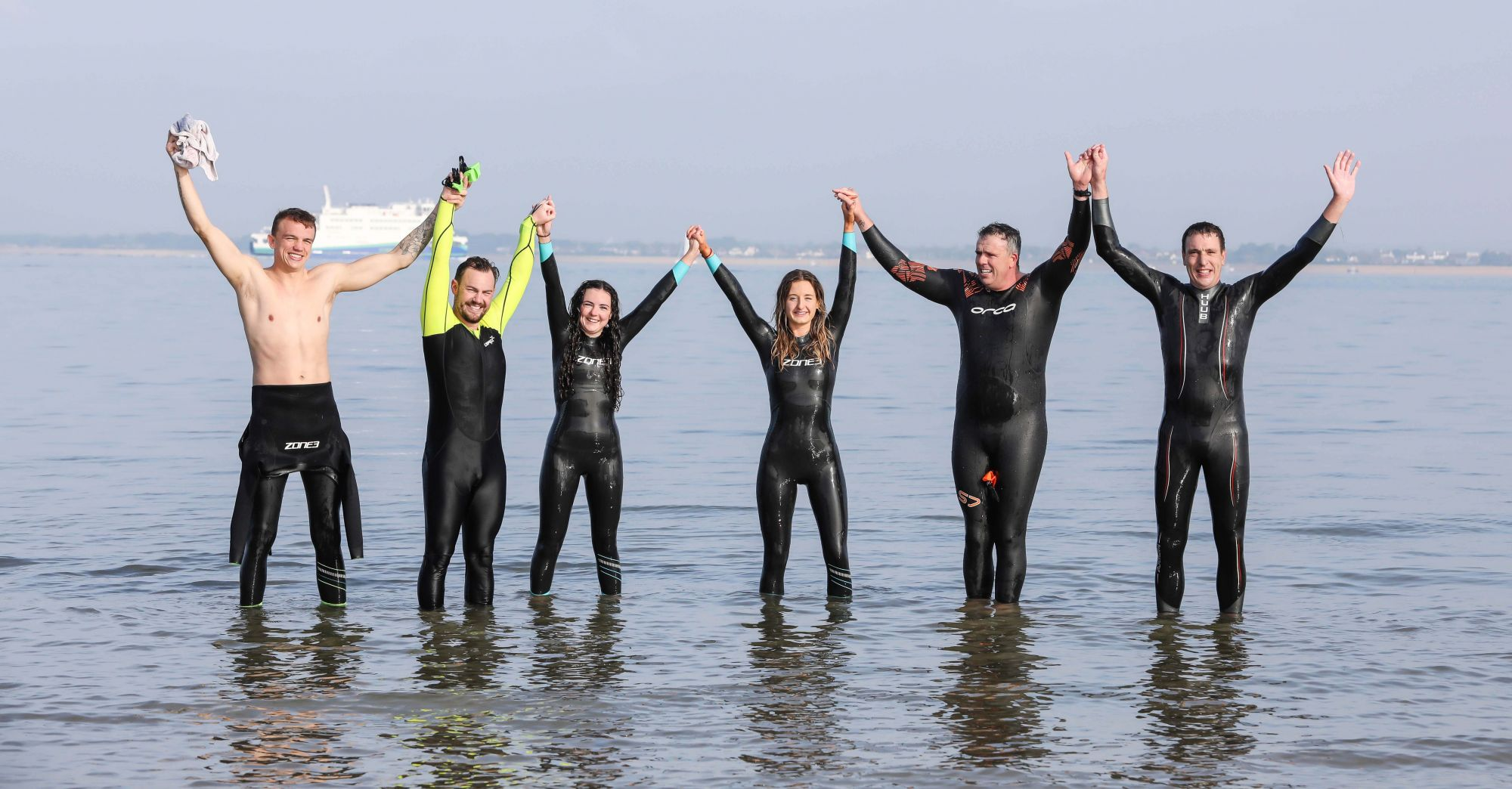 MADE IT! Employees of Trant Engineering took part in a charity swim across the Solent from Gosport to Ryde, Isle of Wight. Pictured are the victorious members of the team after successfully completing the crossing. From left, James Stead (Project Engineer), Terry Elstone (Consultant Commercial Manager), Jess Howe (Buyer), Louisa Davies (Quantity Surveyor), David Graham (Framework Manager) and James Henderson (Director – Process and Water).