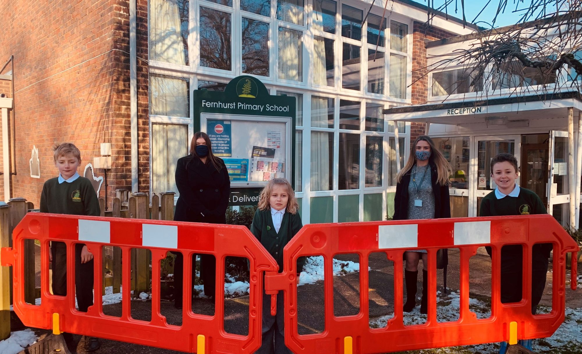 THANK-YOU: Children at Fernhurst Primary School in Fernhurst, Haslemere, can play more safely in the playground during the pandemic, thanks to 15 social-distancing barriers donated by Trant Engineering. Headteacher Jen Thornton is pictured left with Emma Quinnell-Spencer, a Compliance Advisor at Trant Engineering, along with Emma's son Stuart, right, Emilia and Arthur.
